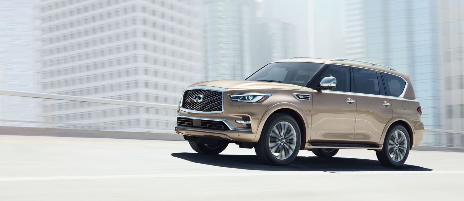 INFINITI QX80 driving in the city