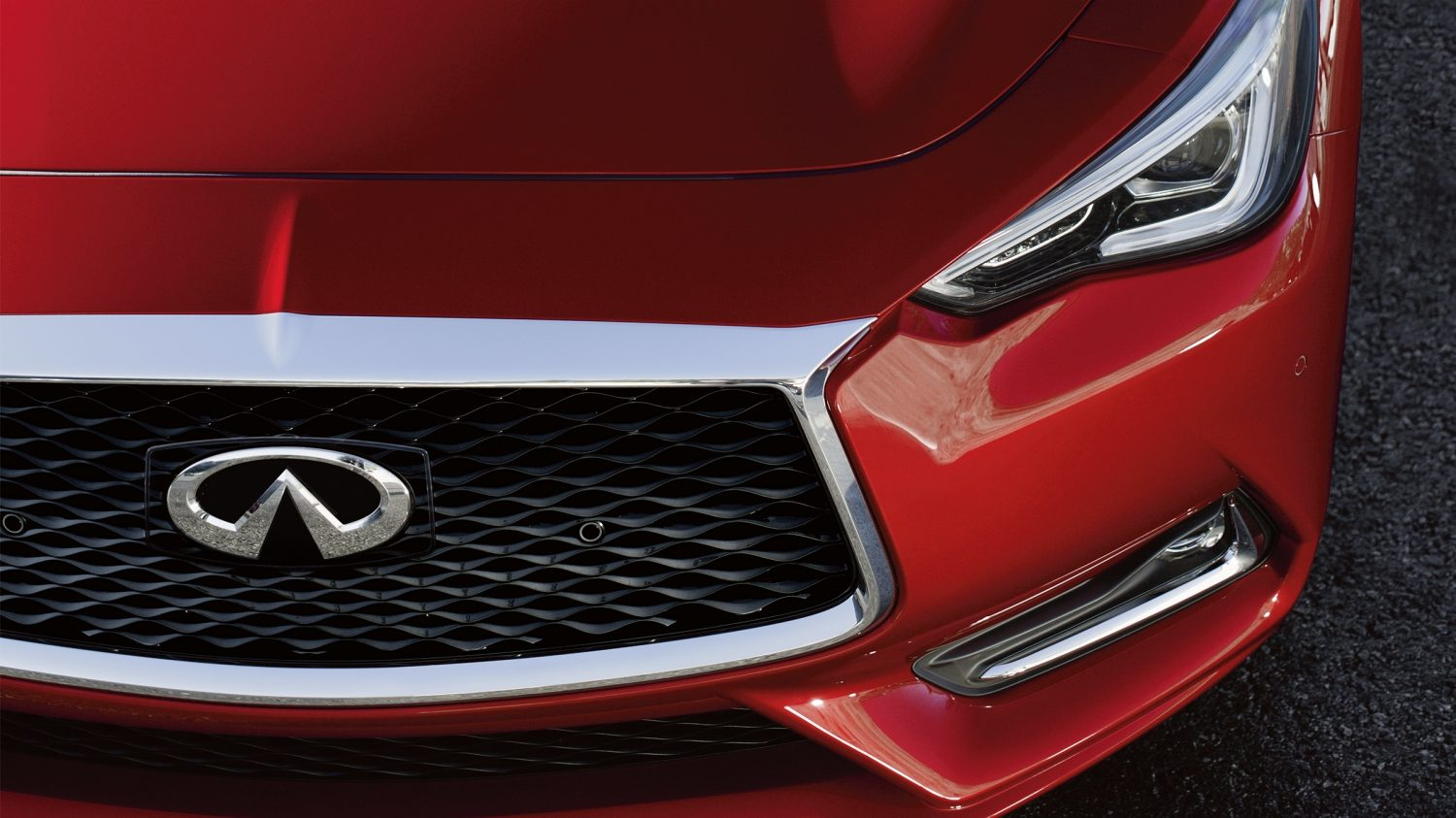 INFINITI Q60 in red front of vehicle hood
