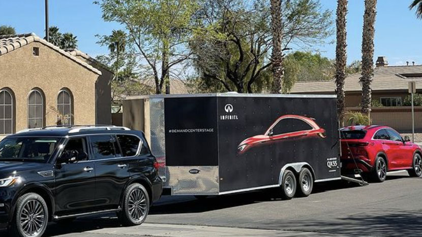 Side profile of 2022 INFINITI QX55 towing