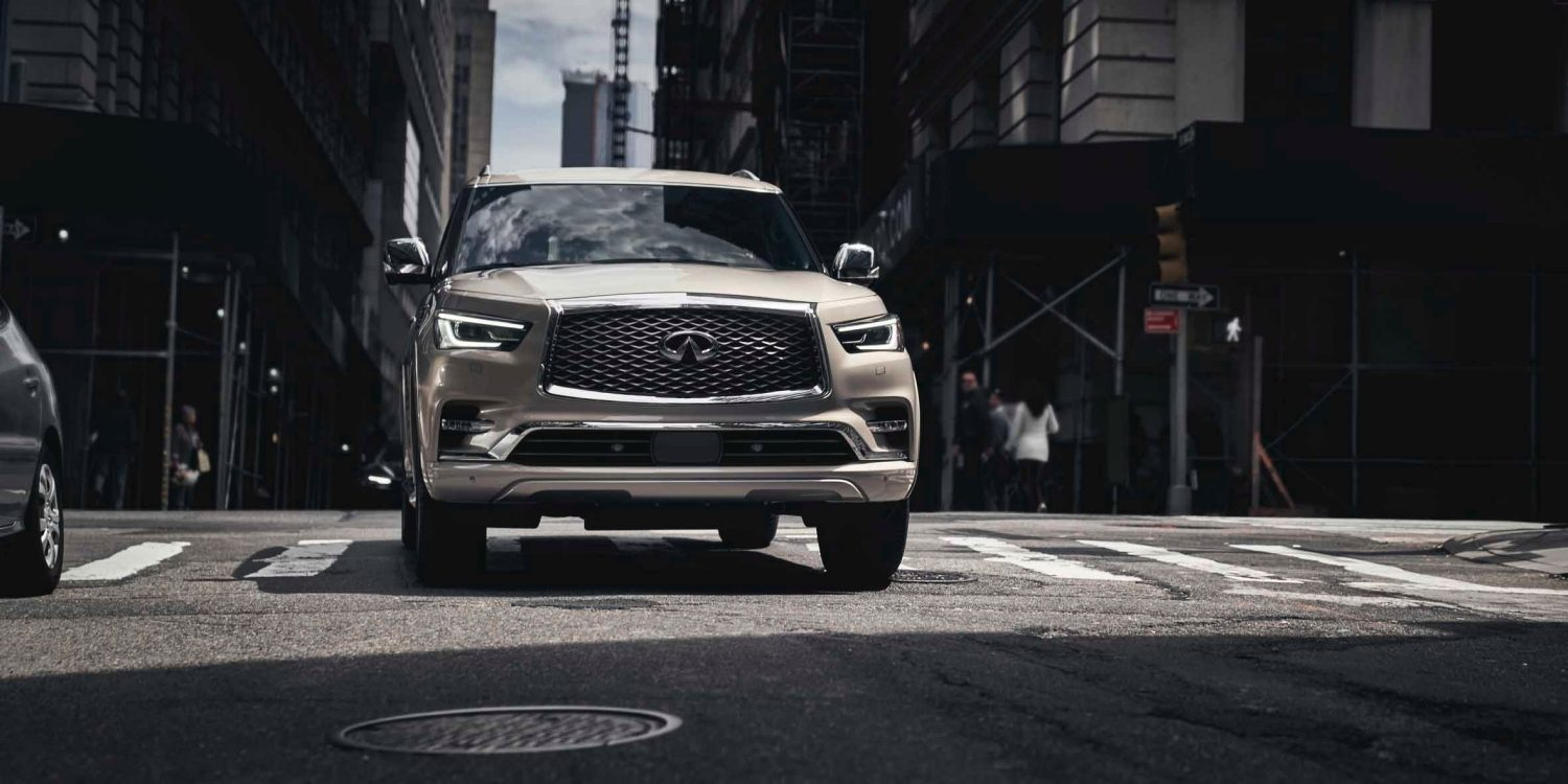 Front profile of a 2021 INFINITI QX80 SUV on the road