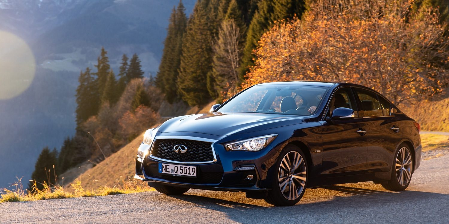 INFINITI Q50 park on a mountainous roadside