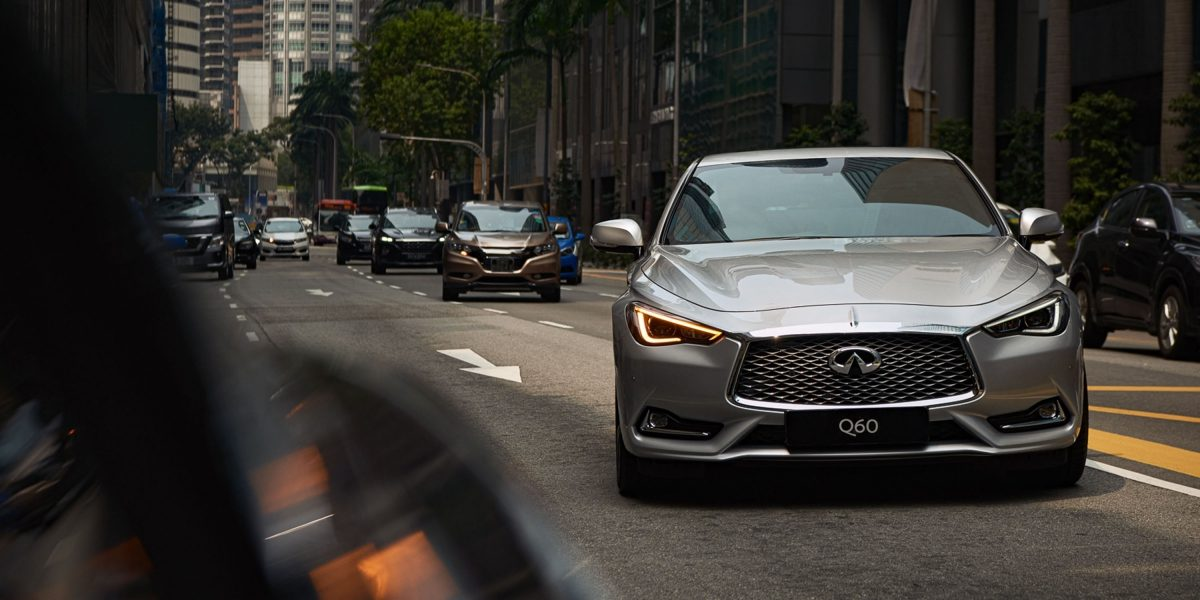2020 INFINITI Q60 Red Sport 400 Sports Coupe Design Driving on the Road Front View