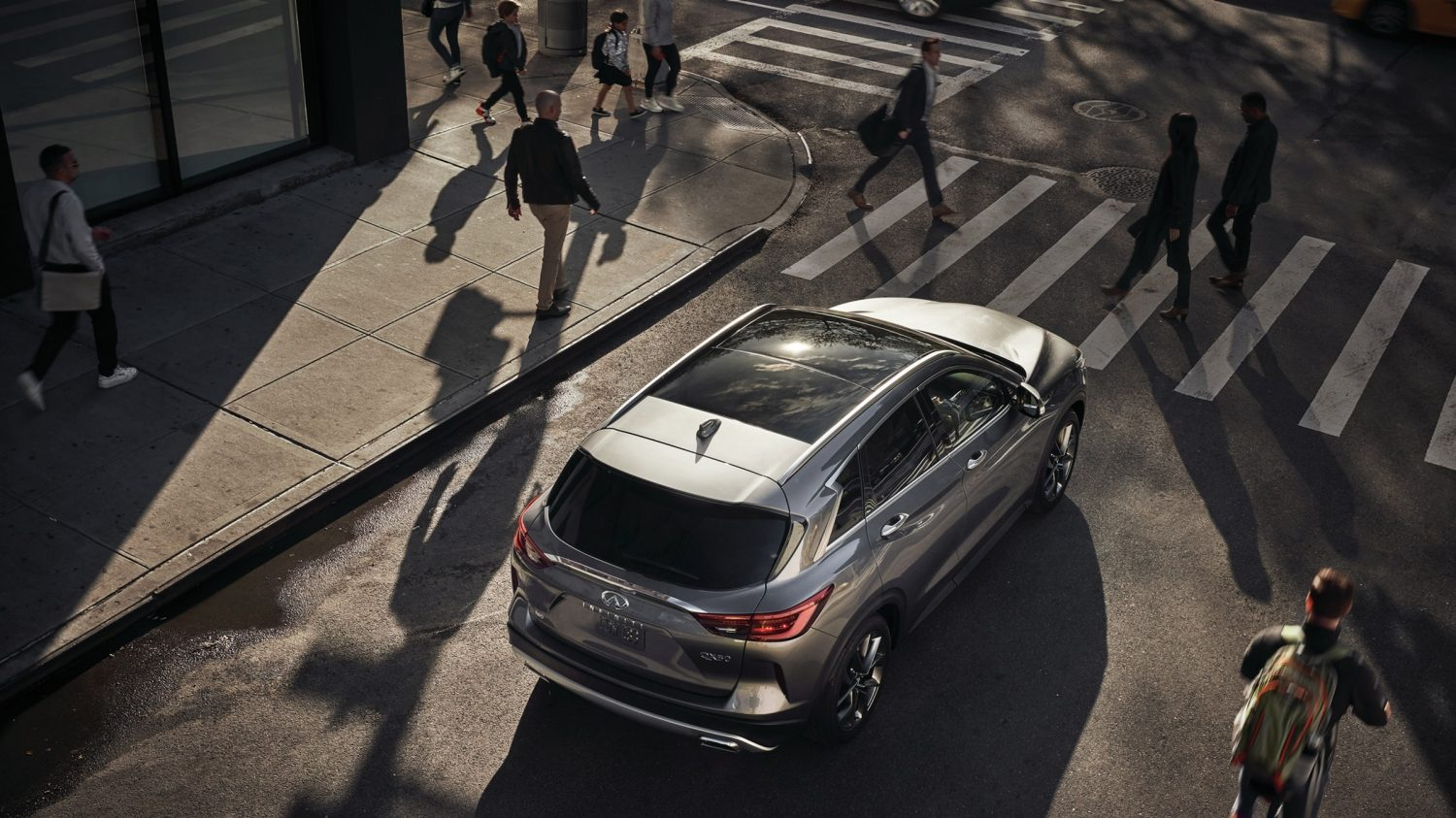 2020 INFINITI QX50 Luxury Crossover Parked To The Side At Crossing