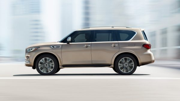 2018 INFINITI QX80 Luxury SUV Commanding Stance | Driver's Side Full Profile in Champagne Quartz