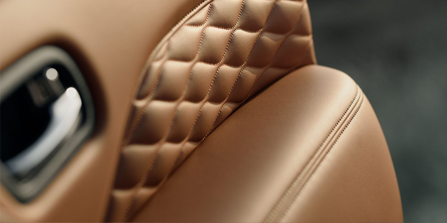 2018 INFINITI QX80 SUV Interior Design Gallery | High-Caliber Intricate Mocha Burl Stitching in Saddle Brown