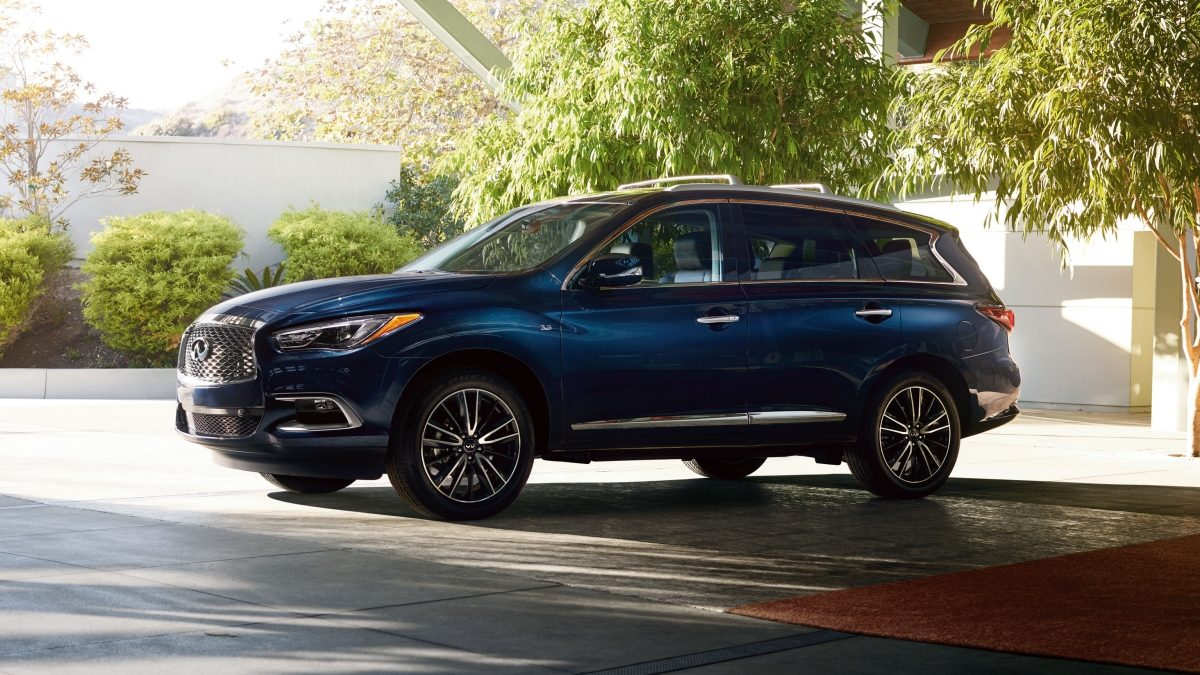 INFINITI QX60 parked under trees