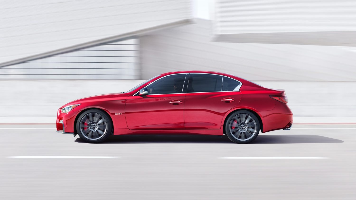 Rear Passenger Side View of the 2018 INFINITI Q50 Red Sport Sedan in Dynamic Sunstone Red